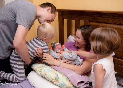 Introducing baby to older sibling at a homebirth.
