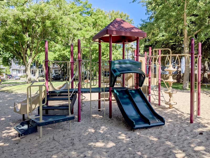 green and burgandy playground on sand in St. Joe, MI